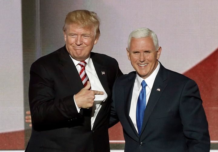 Republican U.S. presidential nominee Donald Trump (L) greets vice presidential nominee Mike Pence after Pence spoke at the Republican National Convention in Cleveland, Ohio, U.S. July 20, 2016.
