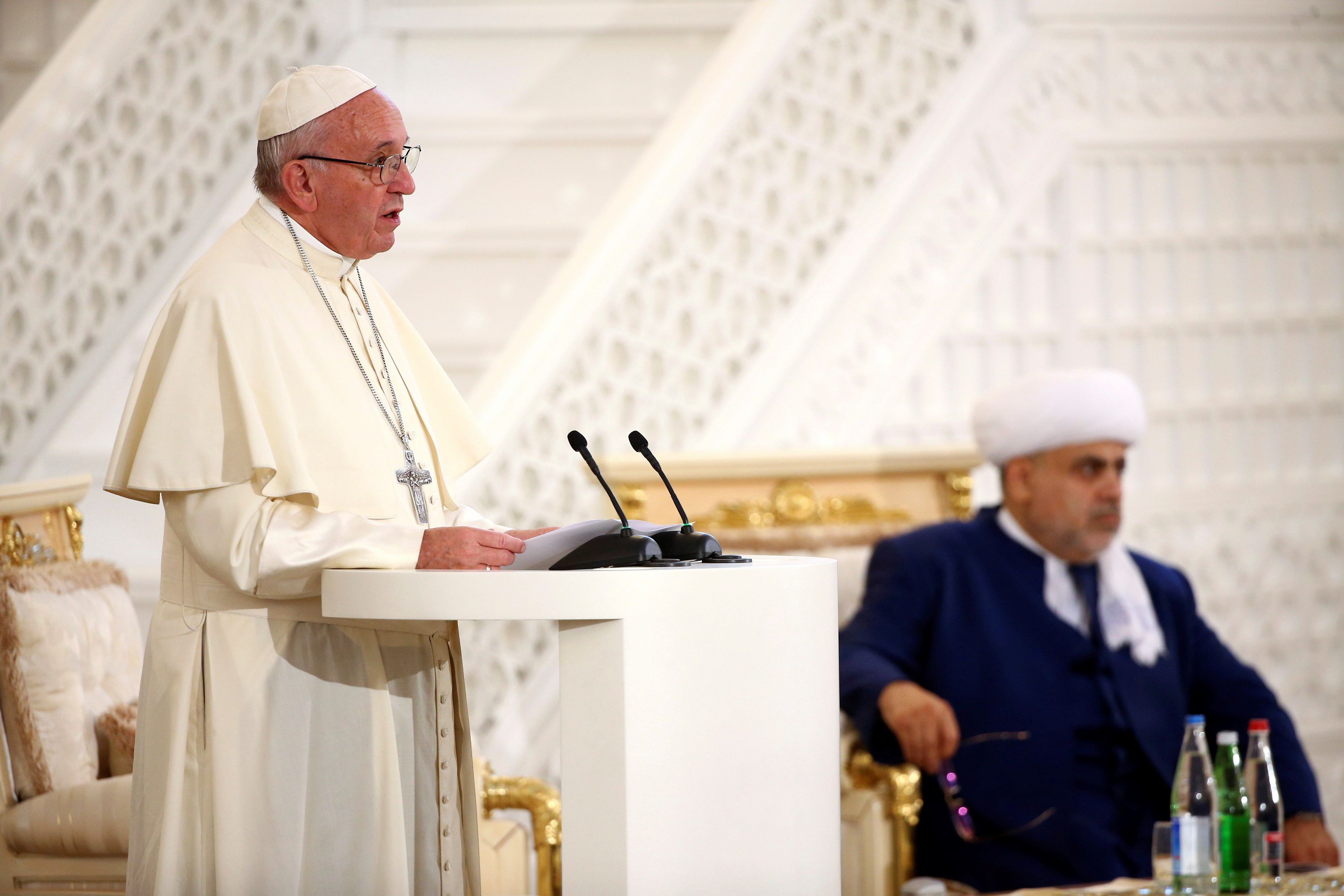 Pope Francis talks during a meeting with Azerbaijan's Grand Mufti Allahshukur Pashazade at the Heydar Mosque in Baku, Azerbaijan October 2, 2016. REUTERS/Alessandro Bianchi