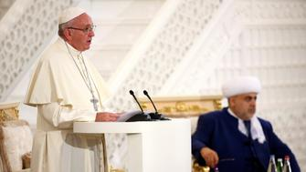 Pope Francis talks during a meeting with Azerbaijan's Grand Mufti Allahshukur Pashazade at the Heydar Mosque in Baku, Azerbaijan October 2, 2016. REUTERS/Alessandro Bianchi