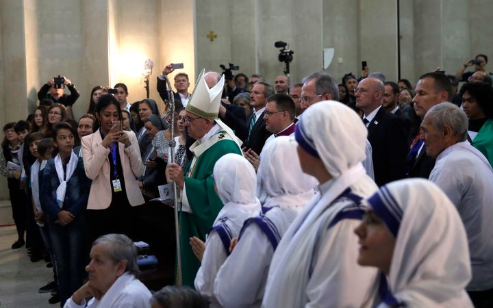 Pope Francis arrives to celebrate a mass in the Immaculate church in Baku, Azerbaijan, on Oct. 2.