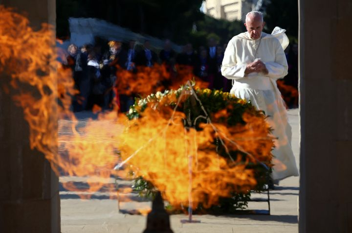 Pope Francis prays at the Azerbaijan Baku City Shadhidlar Hiyabani Monument to the Fallen Heroes on Oct. 2.