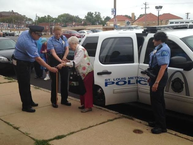 Edie Simms is seen being helped out of a police car following a fun-filled ride on