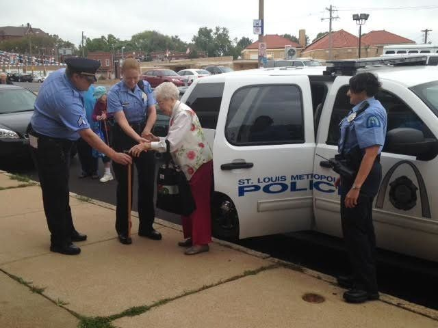 Edie Simms is seen being helped out of a police car following a fun-filled ride on Friday.