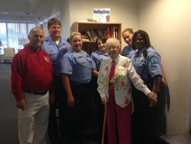Simms is seen posing with some of the police officers that made her special day