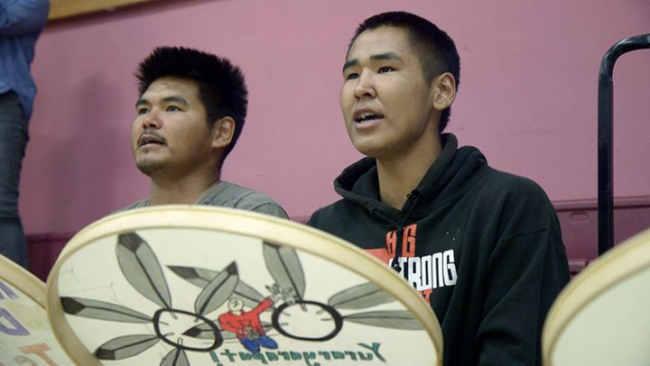 Newtok students practice traditional Yup'ik drumming after school.