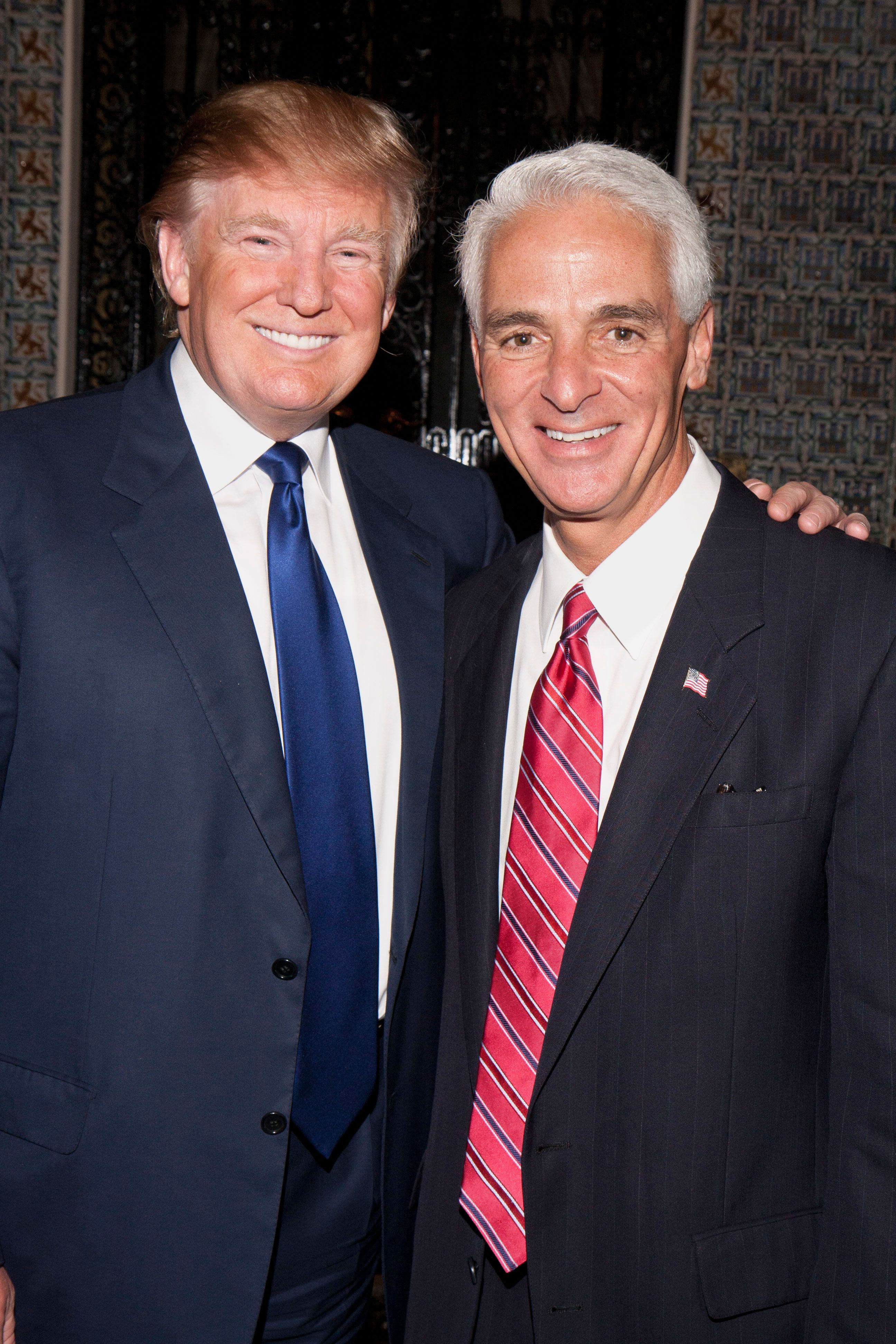 December 12, 2009 December 12, 2009 DONALD TRUMP AND GOVERNOR CHARLIE CRIST Attend Glitz Charity Gala. The March of Dimes Glitz Gala was held at Mar-a-Lago. (Photo by Michele Eve Sandberg/Corbis via Getty Images)