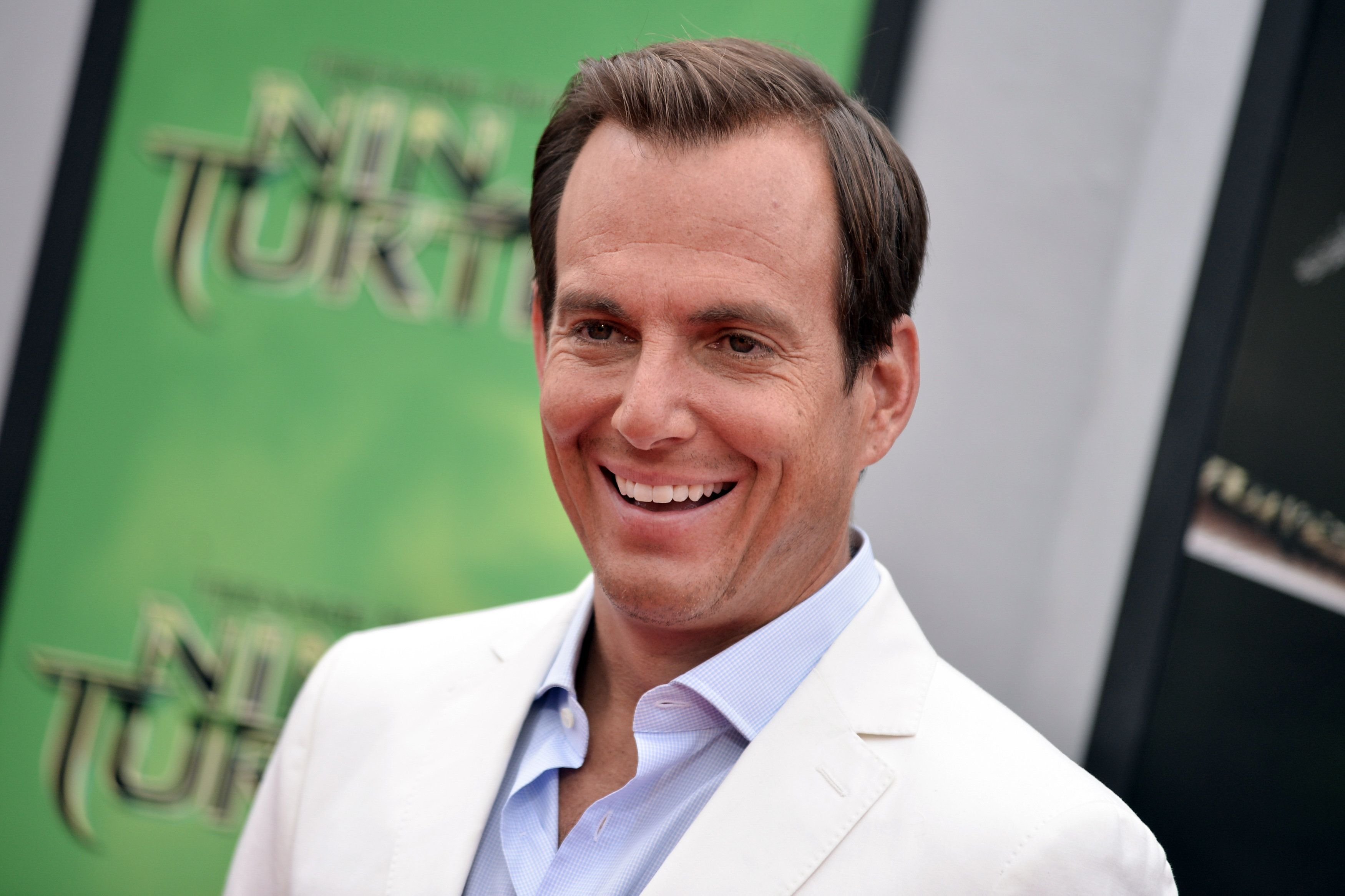 """FILE - In this Aug. 3, 2014 file photo, Will Arnett arrives at the LA Premiere of """"Teenage Mutant Ninja Turtles"""" in Los Angeles. Arnett is producing the new streaming series Game Chat, which features him playing games alongside comedians Peter Giles and Dennis Gubbins in several installments. The show debuts Wednesday, Feb. 11, 2015, and subsequent episodes will launch every other week on Xbox Live and YouTube. (Photo by Richard Shotwell/Invision/AP, File)"""