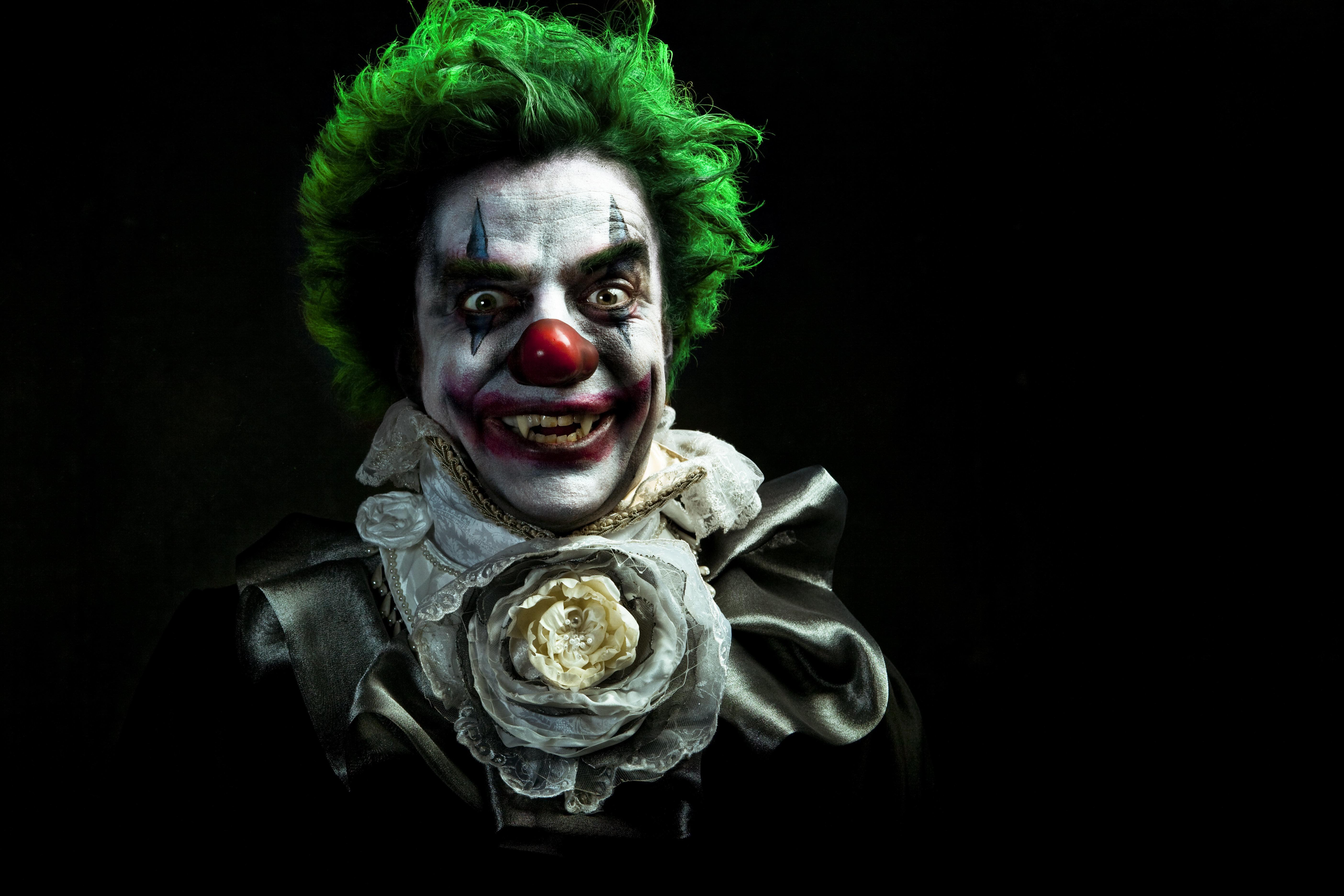 A stock photo of a creepy evil vampire clown against a dark textured background. [url=http://www.istockphoto.com/search/lightbox/10593020#1071a130][IMG]http://www.bellaorastudios.com/banners/new01.jpg[/IMG][/url]