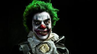 A stock photo of a creepy evil vampire clown against a dark textured background. [url=http://www.istockphoto.com/search/lightbox/10593020#1071a130][IMG]http://www.bellaorastudios.com/banners/new01.jpg[/IMG][/url]