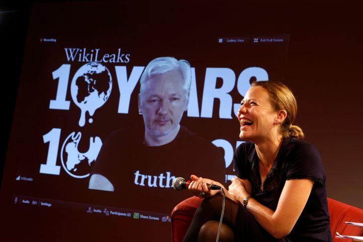 WikiLeaks founder Julian Assange appears via video link with the site's journalistSarah Harrison ata press confer