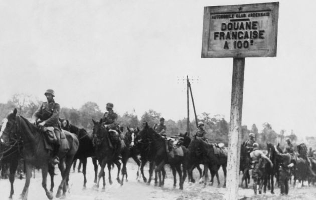 A German mounted reconnaissance unit leaving the Ardennes, crossing the Belgian border to