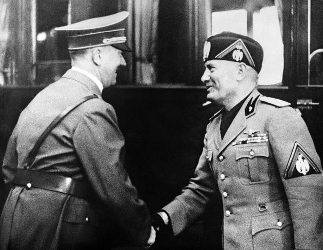 Hitler, greeting Benito Mussolini in