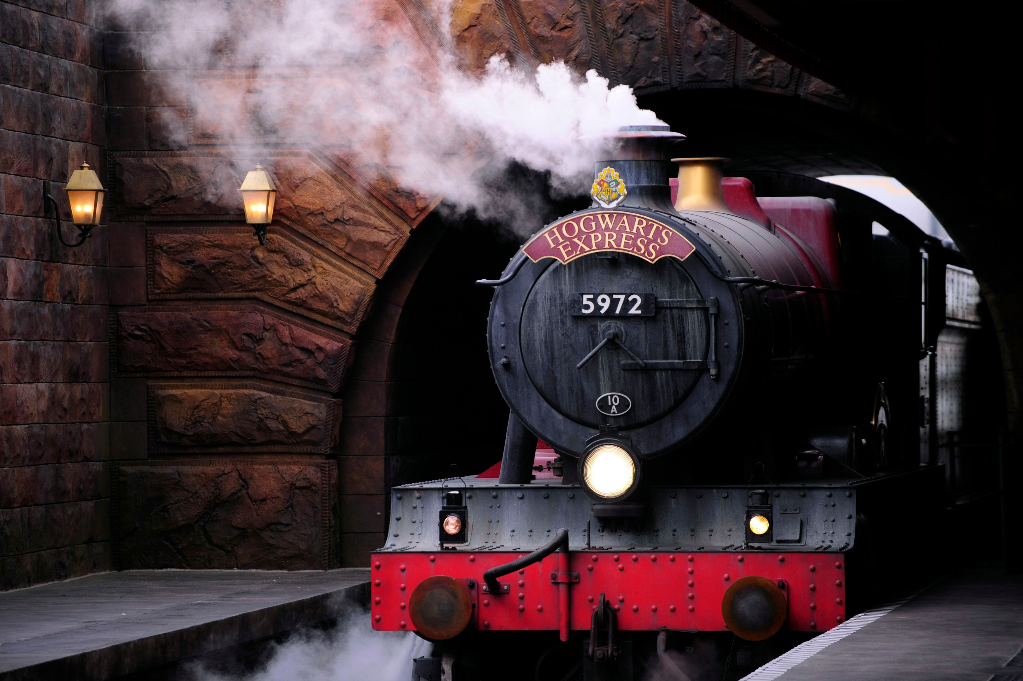 The Hogwarts Express train, which connects the Universal Studios with neighboring Islands of Adventure, pulls into the Hogsmeade Station during a media preview for The Wizarding World of Harry Potter-Diagon Alley at the Universal Orlando Resort in Orlando, Florida June 19, 2014. The new attraction, which opens to the public on July 8, expands the original Harry Potter world, which opened in 2010 and is modeled after Hogsmeade Village, which is located near the Hogwarts School of Witchcraft and Wizardry where the series' leading character Harry Potter begins his magical adventures. REUTERS/David Manning  (UNITED STATES - Tags: ENTERTAINMENT BUSINESS SOCIETY)