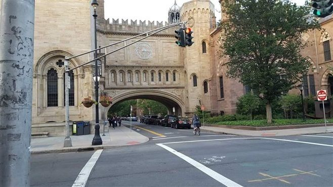 A New Haven city street leads to the Yale campus. Some states and cities are considering a property tax on nonprofits like Ya
