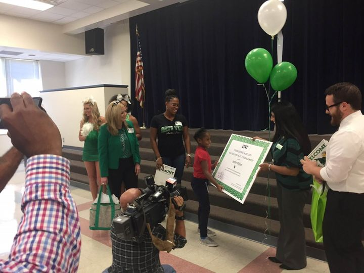 Jordin Phipps, in red, receiving her award during an assembly at her elementary schoolSept. 29.