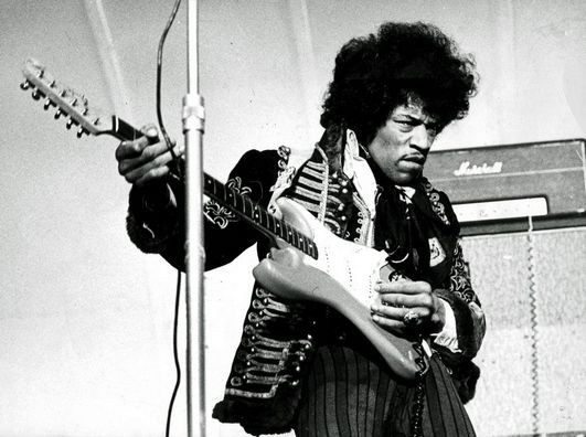 Jimi Hendrix performs on stage in 1967.