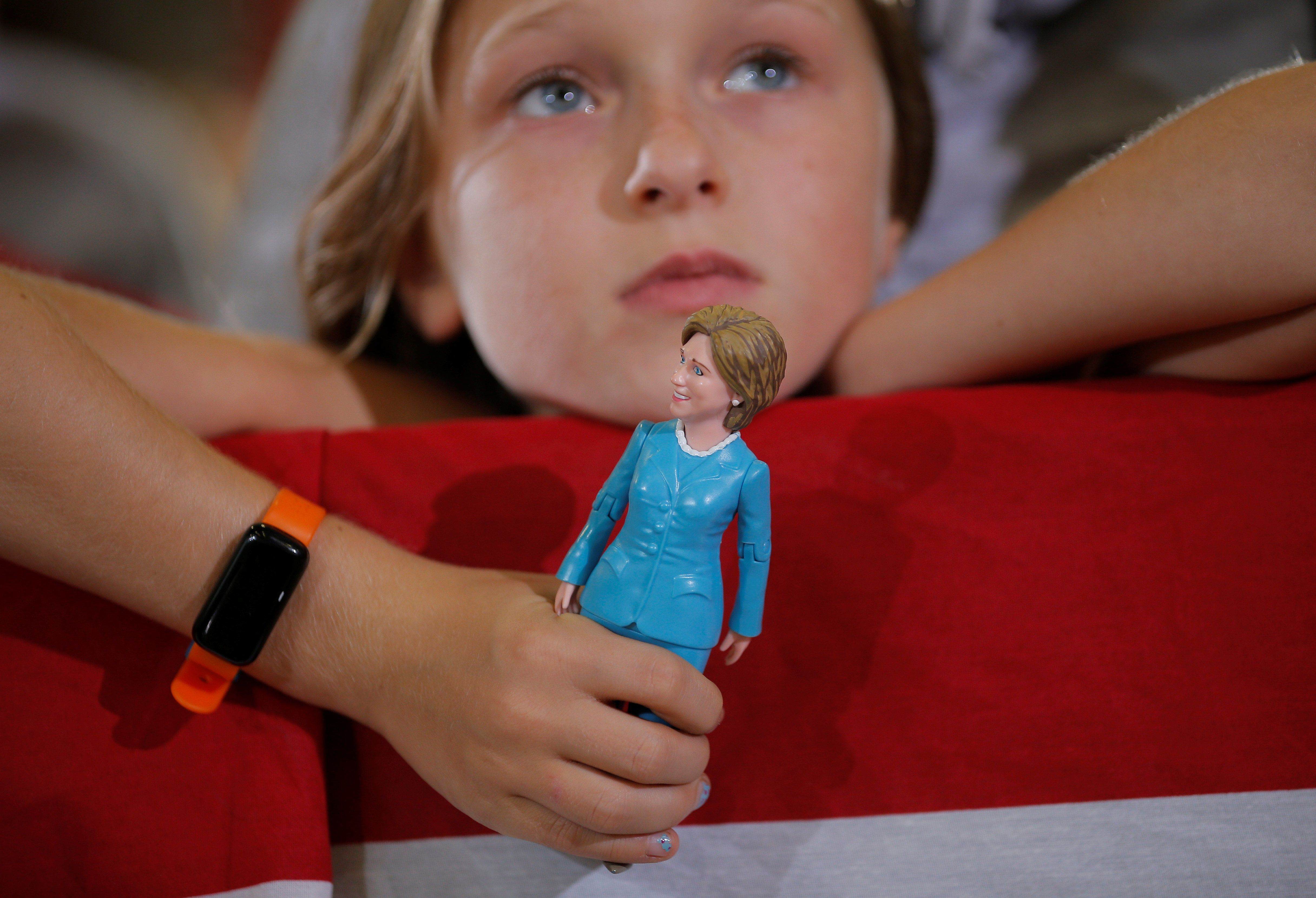 Nine-year-old Belle Shefrin holds a doll of U.S. Democratic presidential nominee Hillary Clinton while listening to Clinton speak at a campaign rally in Akron, Ohio, U.S., October 3, 2016.  REUTERS/Brian Snyder      TPX IMAGES OF THE DAY