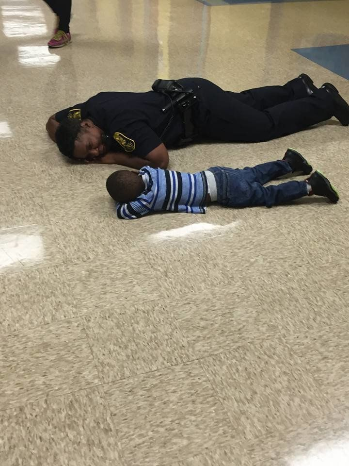 Cop Gets On Level With Boy Having A Bad Day, Wipes His