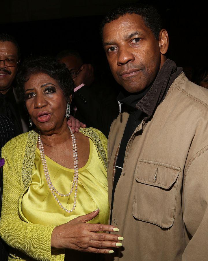 Aretha Franklin and Denzel Washington at Franklin's 72nd birthday celebration on March 22, 2014, in New York City.