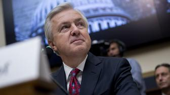 John Stumpf, chief executive officer of Wells Fargo & Co., waits to begin a House Financial Services Committee hearing in Washington, D.C., U.S., on Thursday, Sept. 29, 2016. Stumpf, fighting to keep his job amid a national political furor, will forgo more than $41 million of stock and salary as the banks board investigates how employees opened legions of bogus accounts for customers. Photographer: Andrew Harrer/Bloomberg via Getty Images
