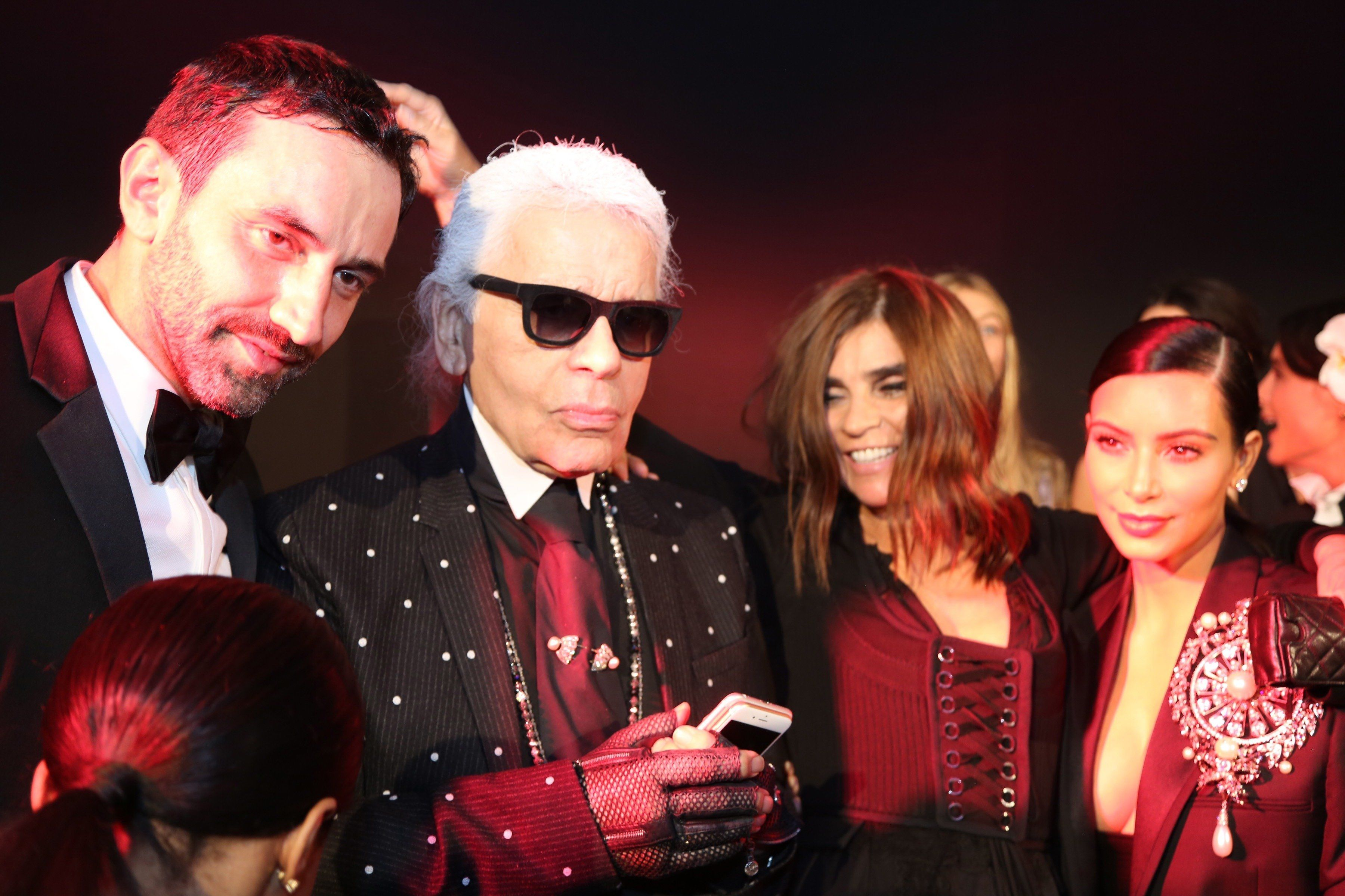 PARIS, FRANCE - SEPTEMBER 30: Riccardo Tisci, Karl Lagerfeld, Carine Roitfeld and Kim Kardashian attend the CR Fashion Book Issue No.5 Launch Party hosted by Carine Roitfeld and Stephen Gan at The Peninsula Paris on September 30, 2014 in Paris, France.  (Photo by Antonio de Moraes Barros Filho/WireImage)