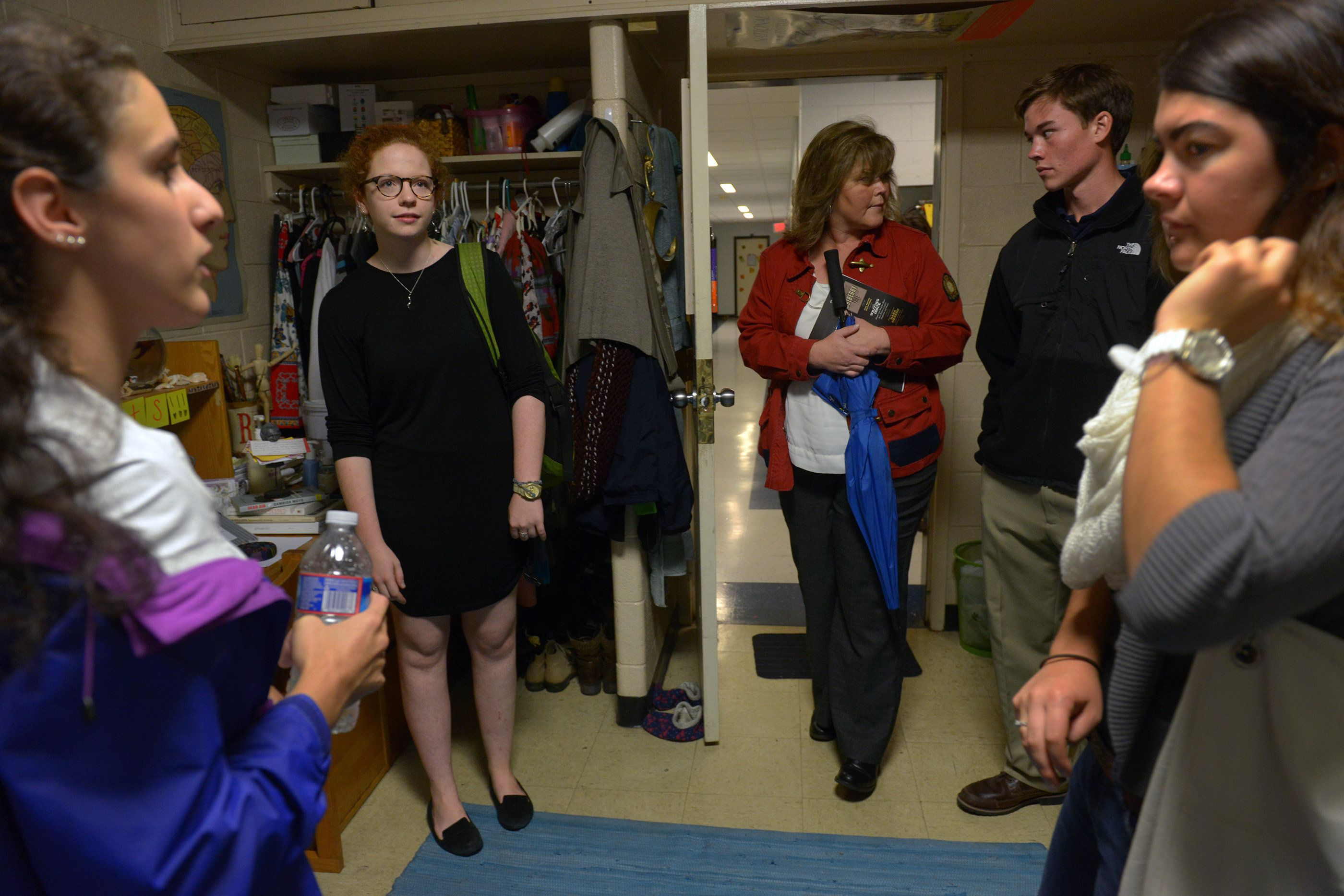 ST. MARY'S, MD	 - NOVEMBER 1: Sophomore Elaine Buckman, second left, hosts a tour of her dorm room as Bianca Calin, left, leads high school seniors Mike Dorsch, second right, and Alex Lucas, far right, through St. Mary's college with prospective enrollment in the balance on November, 01, 2013 in St. Mary's, MD.  Mike's mother, Diana Dorsch, is in red. (Photo by Bill O'Leary/The Washington Post via Getty Images)