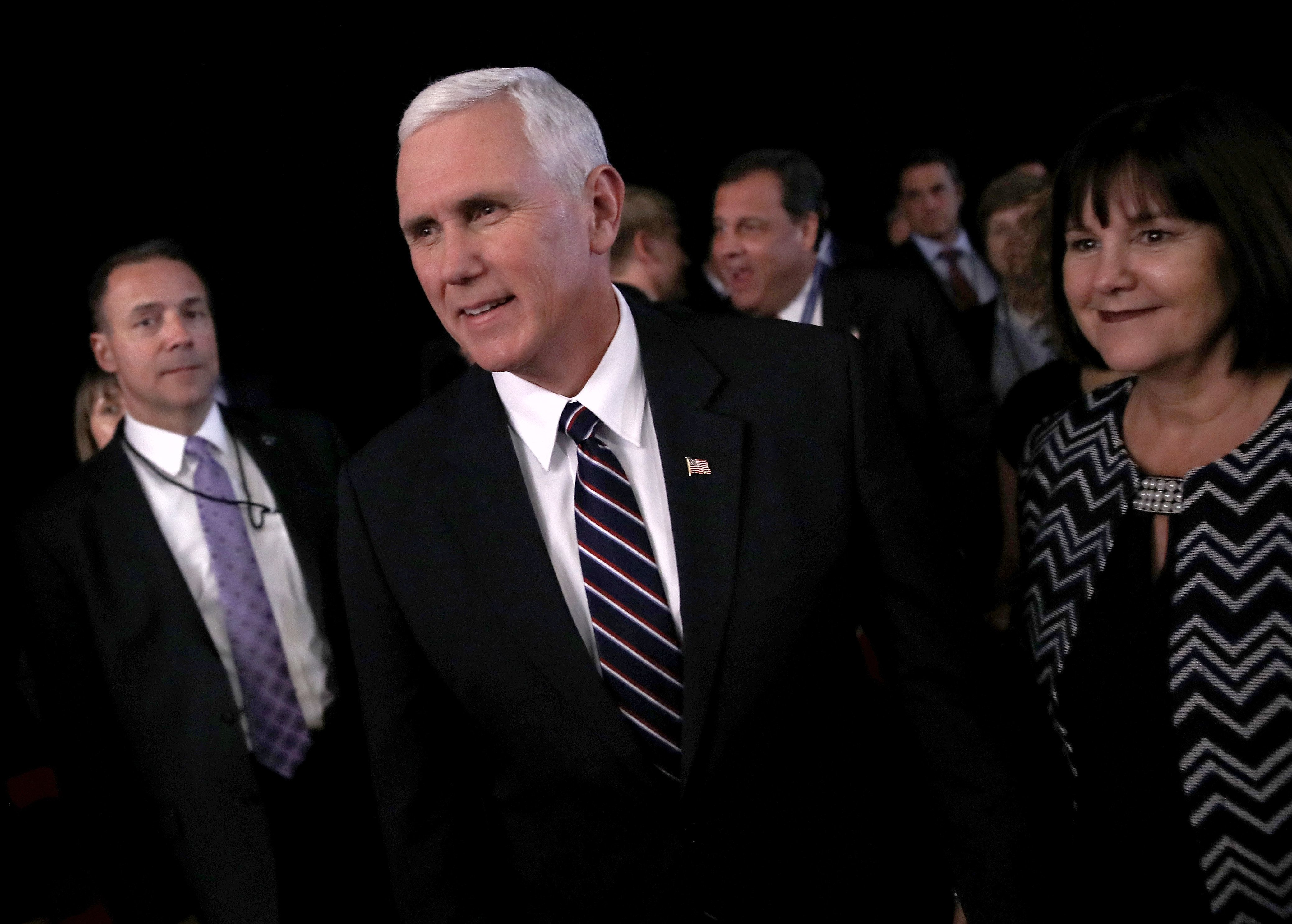 HEMPSTEAD, NY - SEPTEMBER 26:  Republican Vice presidential nominee Mike Pence (C) attends the Presidential Debate at Hofstra University on September 26, 2016 in Hempstead, New York.  The first of four debates for the 2016 Election, three Presidential and one Vice Presidential, is moderated by NBC's Lester Holt.  (Photo by Win McNamee/Getty Images)