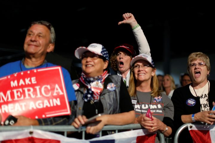 People jeer Hillary Clinton as Republican presidential nominee Donald Trump holds a rally at the Suburban Collection Sh