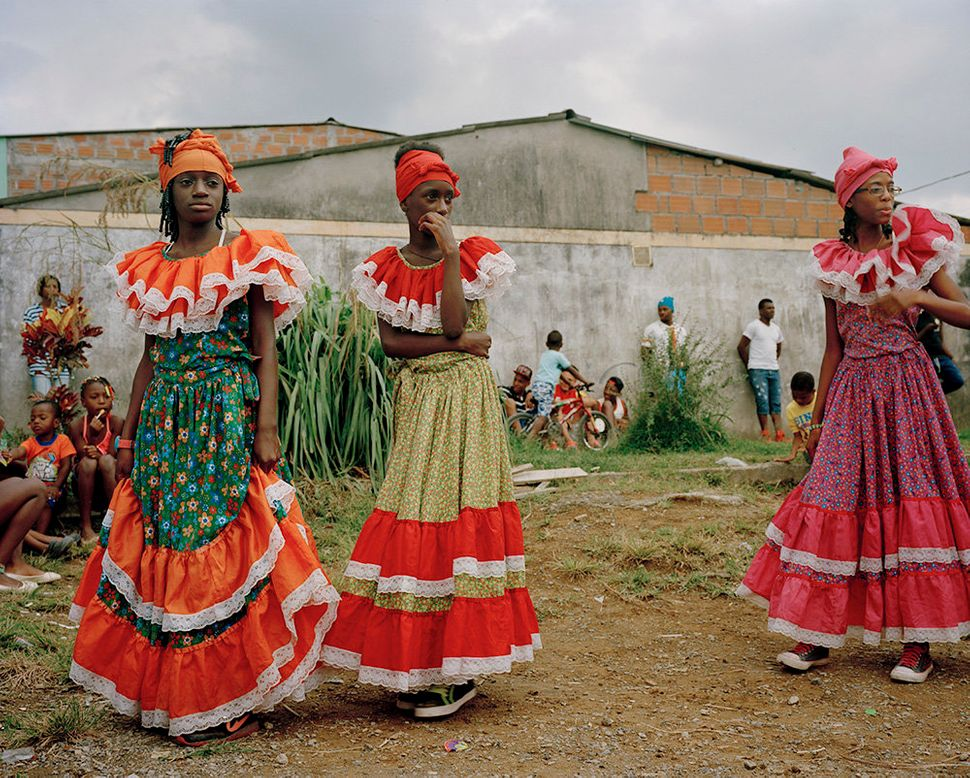 Afro-Colombian youth prepare to perform for a small community that hosts many displaced families.