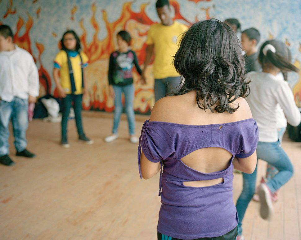 Through dance workshops, young participants learn how to express themselves through movement, and survivors of violence regai
