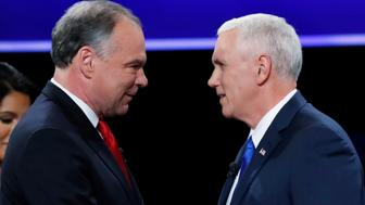 Democratic U.S. vice presidential nominee Senator Tim Kaine (L) and Republican U.S. vice presidential nominee Governor Mike Pence shake hands as they arrive for their vice presidential debate at Longwood University in Farmville, Virginia, U.S., October 4, 2016. REUTERS/Kevin Lamarque