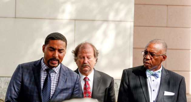 Keith Scott family attorneys Justin Bamberg, Charles Monnett and Eduardo Curry (left to right) give a...