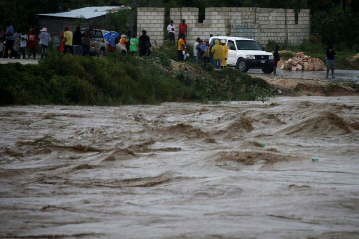 Water rises in a river in Port-au-Prince, Haiti as rains caused by Hurricane Matthew cause flooding.
