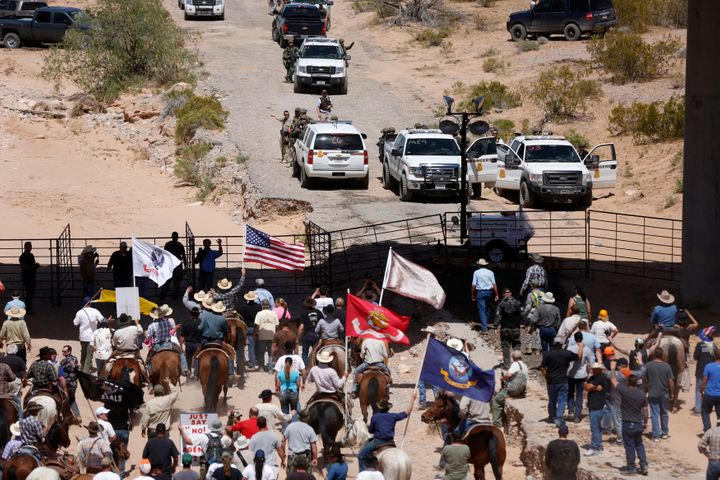 Protesters gather at the Bureau of Land Management's base camp, where cattle that were seized from rancher Cliven Bundy are b