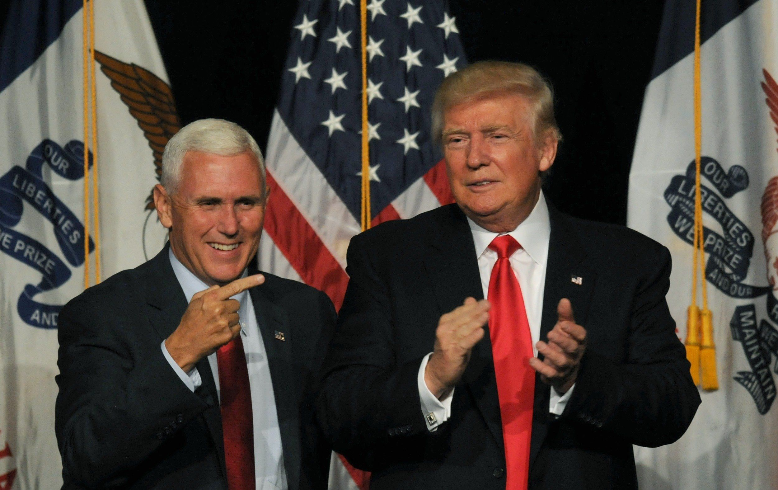 DES MOINES, IA - AUGUST 5 : Republican Presidential Candidate Donald Trump and Vice Presidential candidate, Indiana Governor Mike Pence greets supporters at a rally at the Iowa Events Center in Des Moines, Iowa on Friday August, 5, 2016. (Photo by Steve Pope/Getty Images)