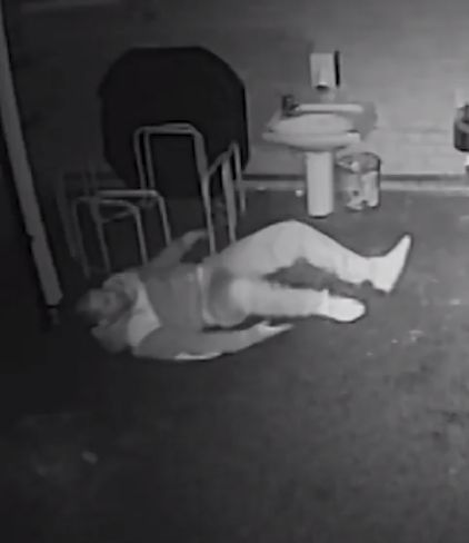 The burglar winces in pain after hurting his leg after falling from the ceiling of the Lewisham