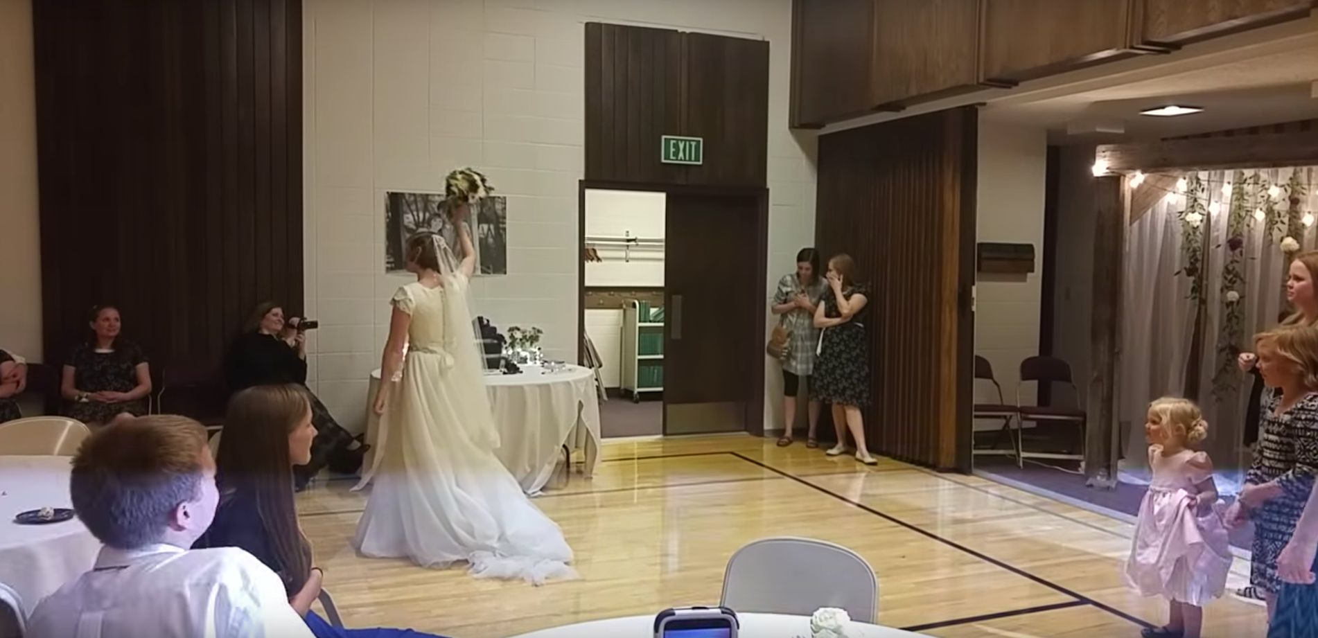 Bride Stuns Wedding Guests By Throwing Bouquet Through Basketball