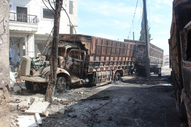 The wreckage of Syrian Red Crescent aid trucks at Urum al-Kubra region in Aleppo, Syria, after the airstrikes...