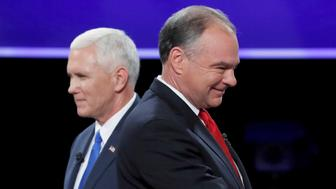 Democratic U.S. vice presidential nominee Senator Tim Kaine and Republican U.S. vice presidential nominee Governor Mike Pence (L) pass each other after the conclusion of their vice presidential debate at Longwood University in Farmville, Virginia, U.S., October 4, 2016. REUTERS/Kevin Lamarque      TPX IMAGES OF THE DAY