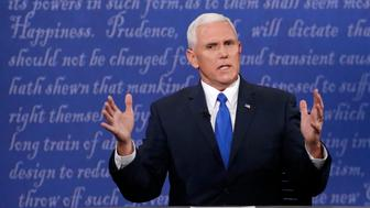 Republican U.S. vice presidential nominee Governor Mike Pence discusses an issue with Democratic U.S. vice presidential nominee Senator Tim Kaine (off camera) during their vice presidential debate at Longwood University in Farmville, Virginia, U.S., October 4, 2016.       REUTERS/Jonathan Ernst