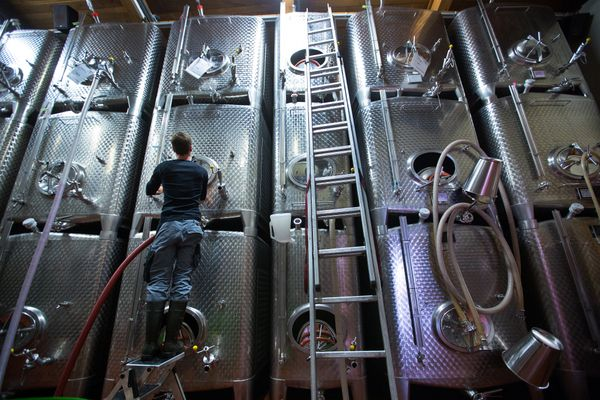 A worker prepares white wine fermentation tanks for use on the Weingut Friedrich Becker Estate.