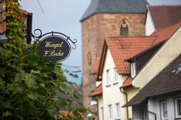 A sign hangs outside the Weingut Friedrich Becker Estate winery in Schweigen, Germany.