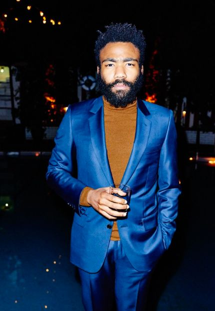 Glover is our favorite of all the Dandy Wildmen. Especially when he wears his hair and beard with a magnificent suit like this.