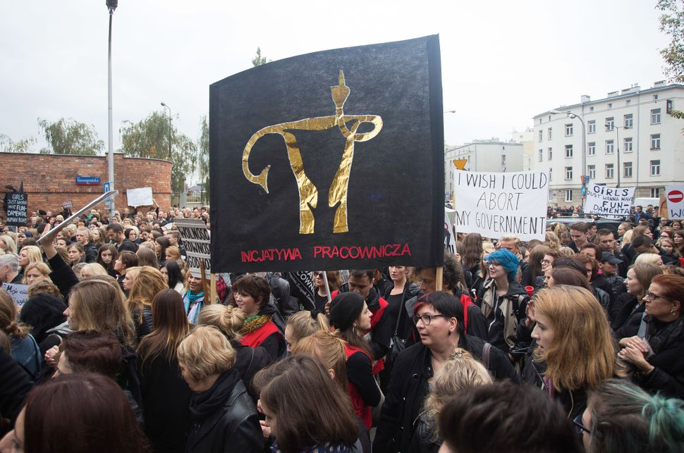 Men and women gather in Warsaw to protest.