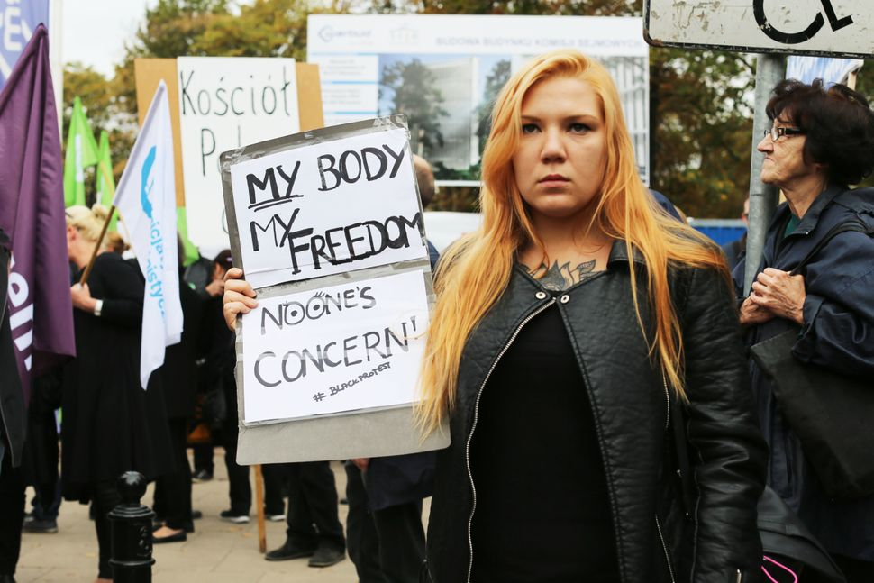 A young woman marches in Warsaw.