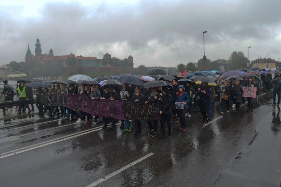 Pro-abortion rights protesters march in the rain on Krakow's Debnicki Bridge en routeto the mainsquare.