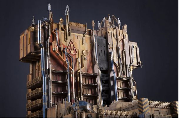 """The building is transformed into a giant warehouse belonging to """"The Collector."""" It's """"surging with power, rising into the sky,"""" as Disney's Joe Rohde put it."""