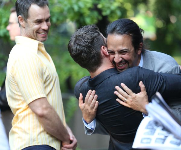 Lin grimaces in triumph, knowing he edged out Jonathan Groff (the guy being hugged) in cuteness.