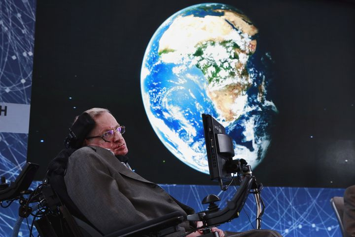 At age 74, Stephen Hawking sits onstage during an announcement of the Breakthrough Starshot initiative with investor Yuri Mil