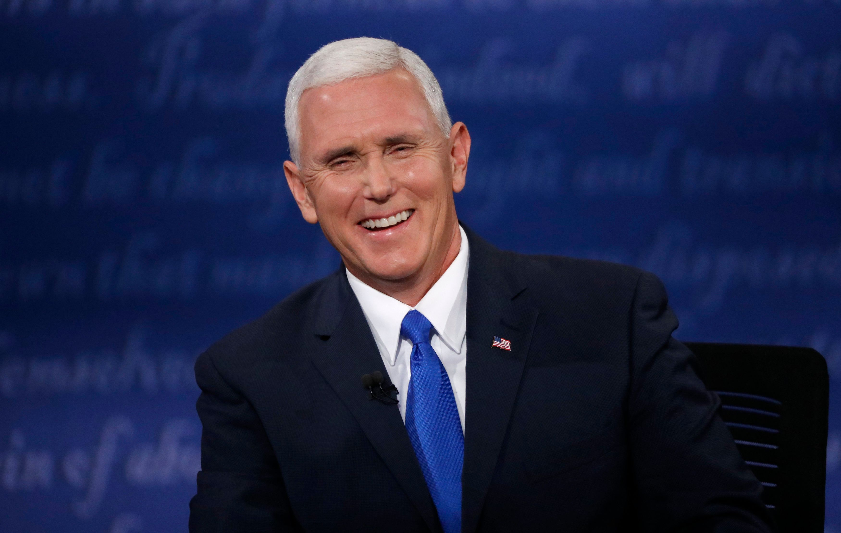 Republican U.S. vice presidential nominee Governor Mike Pence laughs as he discusses an issue with Democratic U.S. vice presidential nominee Senator Tim Kaine (off camera) during their vice presidential debate at Longwood University in Farmville, Virginia, U.S., October 4, 2016.       REUTERS/Jonathan Ernst